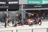 Mark Webber enters his pit area