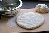 Cooking Ossetian Pies With Beet Tops And Cheese, Third Step. Rolling Billet For The Ossetian Pie In  poster
