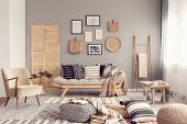 Stylish Living Room Interior Design With Scandinavian Settee, Grey Wall And Natural Accents poster