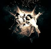 Hip-hop dance party. Couple hip-hop dancing on dark smoke background poster