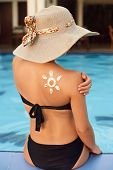 Woman Applying Sunscreen Creme On  Tanned  Shoulder. Skincare. Body Sun Protection Sun Cream. Bikini poster