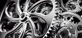 Mechanism, gears and cogs at work. Industrial machinery. Close-up, detailed. 3D illustration poster