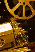 Antique Gold Color Projector With The Film