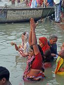 Hindus Perform Ritual Puja At Dawn In The Ganges River