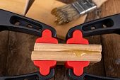 Gluing Wood With Waterproof Adhesive. Pieces Of Wood Pressed Together With Carpentry Clamps. poster