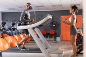 Side view of an African-American athletic man doing a fitness test using a mask while using a treadm poster