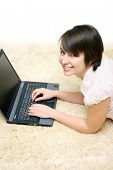 Smiling Darkhaired Girl With Laptop
