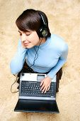 Girl Listening Music From Laptop