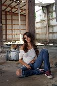 Beautiful Brunette Sitting In An Abandoned Warehouse (1)