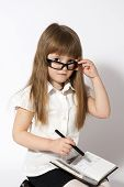 Girl Wearing Glasses With Notebook