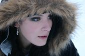 foto of ankh  - beautiful young woman wears warm hooded coat for the cold snowy weather - JPG