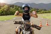 Pretty Girl In A Motorcycle Helmet On A Motorbike Shows Key And Driving Licence. Concept Driving Sch poster