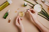 Woman Cosmetologist Cosmetics Testing. Natural Organic Cosmetics. Serum Hair Mask. Flat Lay Pastel poster