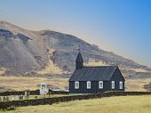 Famous Black Church Of Budir At Snaefellsnes Peninsula Region In Iceland. Amazing Rocks And Mountain poster