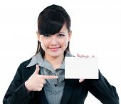 Young Businesswoman Pointing At Blank Card
