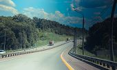 Russian Asphalt Roads. Highway. Road Trip. The Car Goes On The Road. Background Asphalt Road. poster