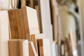 Wooden Pillars And Thick Boards In The Furniture Workshop Are Ready To Work Joiner, Selective Focus poster