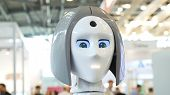Womans Face On A High-tech Robot. Media. High-tech Robot At The Exhibition. Robotic Of A Human Like poster