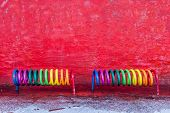 Copenhagen, Denmark - January 14, 2017: A Rainbow Colored Bicycle Rack In Front Of A Red Wall On The poster