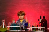 School Chemistry Lessons. School Concept. Child In The Class Room With Blackboard On Background. Chi poster