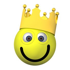 stock photo of smiley face  - Goofy smiley face wearing a crown isolated on white - JPG