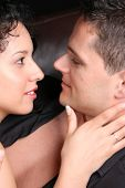 picture of semi-formal  - Young couple in love faces close to one another - JPG