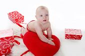 Lovely Baby With Valentine's Heart And Gifts Boxes Over White