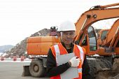 stock photo of heavy equipment operator  - portrait of driver of construction equipment on location site - JPG