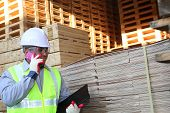 Stock Wood Pallet And Worker