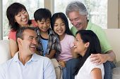 picture of extended family  - Three generation Families sat on sofa smiling together - JPG