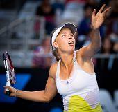 MELBOURNE - JANUARY 19: Caroline Wozniacki of Denmark in her third round win over Lesia Tsurenko of Ukraine at the 2013 Australian Open on January 19, 2013 in Melbourne, Australia.