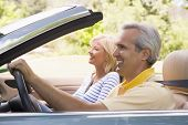 Couples In Convertible Car Smiling