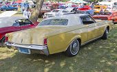 Yellow Lincoln Continental