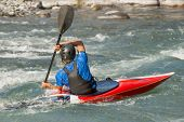 image of kayak  - A whitewater kayaker calculates his next move - JPG