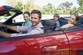Families In Convertible Car Smiling