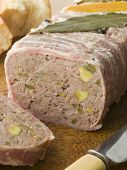 Pate Campagne On A Chopping Board With Rustic Bread