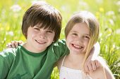 image of young girls  - Portrait of two young children in springtime field - JPG
