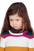Sad little girl with long hair over a white background