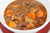 A serving bowl full of freshly home-made oxtail stew, a delicious traditional British or European fo