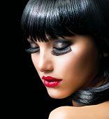 Fashion Brunette Girl Portrait close-up. Beauty Model Woman. Black Hair. Hairstyle. Makeup. Make-up. Long False Eyelashes