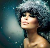 Winter Woman Portrait. Beauty Model Girl. Fur Fashion. Beautiful Girl in Fur Hat
