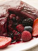 Traditional Summer Pudding With A Scoop Out