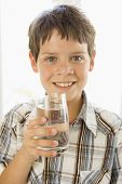 image of drinking water  - Portrait of young girl with glass of orange juice in hand - JPG
