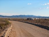 picture of snowbird  - rv trailers parked along the road in the desert in yuma arizona