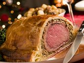 image of beef wellington  - Slice of Beef Wellington with Spinach and Saut ed Potatoes - JPG