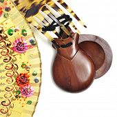 spanish castanets, peineta and hand fan on a white background