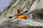 Caucasian man kayaking in river