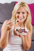 Portrait Of Lovely Blonde Woman Eating Cereals With Fruit At Breakfast
