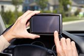 Car driver hands with GPS. Road destination.
