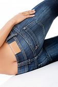 picture of bare butt  - Fit female butt in blue jeans  - JPG